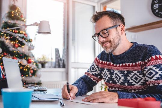 Men writing greeting cards