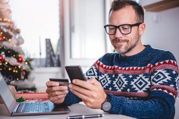 Men shopping online during christmas