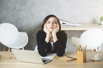 Bored woman at office desk