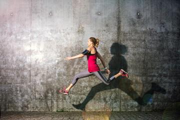 Woman running in urban area