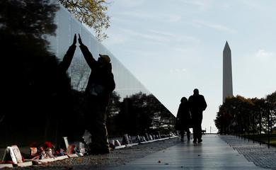 Visitors at the Vietnam Veterans Memorial before Veterans Day in Washington