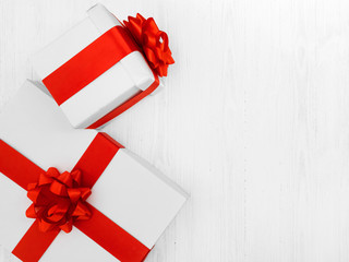 Gift boxes on white wooden textured background