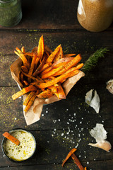 Sweet fried potatoes with spices, salt and sauce