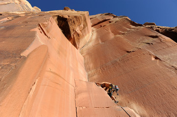 A rock climber scales a rock facing near the Indian Creek area of Bears Ears, New Mexico