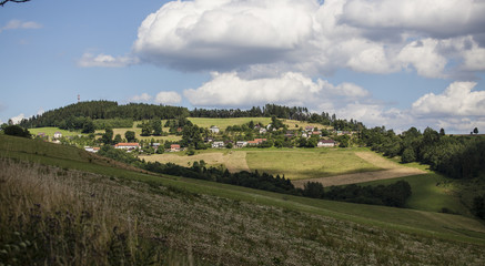 Beautiful Czech summer landscape on hills with forest