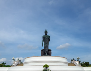 large walking buddha statue in Thailand
