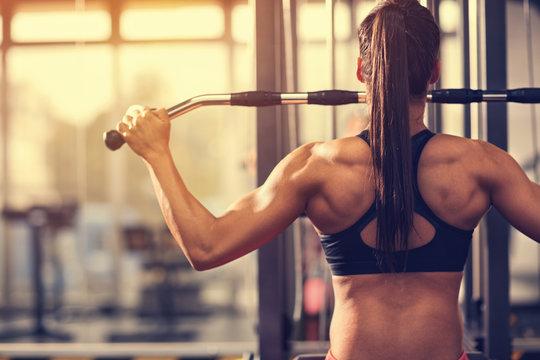Muscular bodybuilder exercising