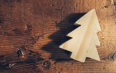 christmas tree symbol on old wood background in greeting card style, including copy space