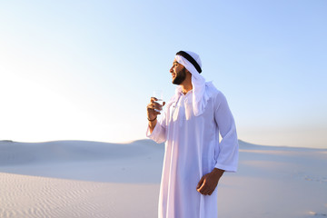 Breath of freshness of male Muslim in middle of dry climate of s