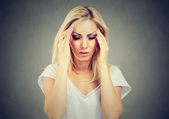 Sad young beautiful woman with stressed face expression looking down