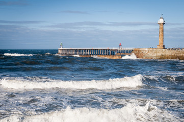 Whitby Light / Whitby Harbour West Pier with heavy seas comming in, Yorkshire, England.
