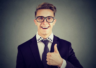 Closeup of a happy man giving thumbs up gesture