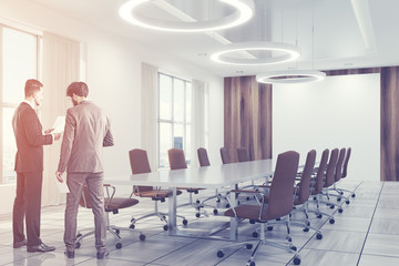 White conference room interior brown chairs people