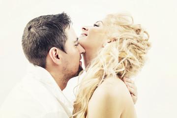 Beautiful couple in love embraces, nude