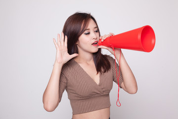 Beautiful young Asian woman announce with megaphone.