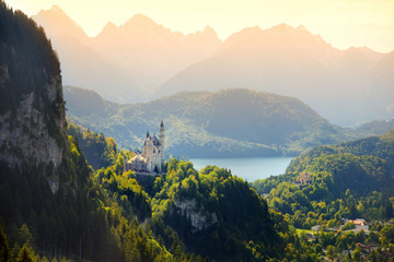 Fototapete - Famous Neuschwanstein Castle, fairy-tale palace on a rugged hill above the village of Hohenschwangau near Füssen in southwest Bavaria, Germany