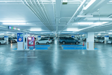 NAKHONRATCHASIMA, THAILAND - JULY 22, 2017 : A lot of cars in garage of department store at night in terminal 21,This place is very famous shopping mall