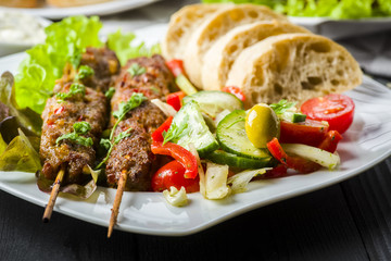 Skewers of minced meat