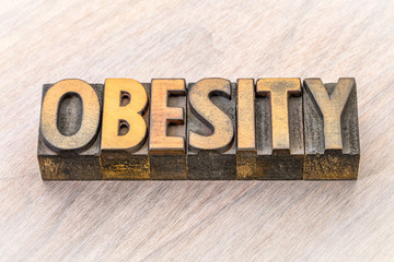 obesity word abstract in wood type