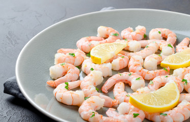 Roasted peeled prawns in a garlic and ginger sauce with herbs an
