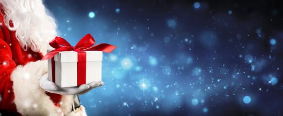 Santa Claus Giving A Giftbox In Magic Night  Wall mural
