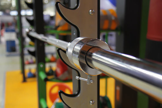 barbells in sport gym on rack close up