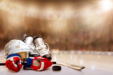 Ice Hockey Helmet, Skates, Gloves, Stick and Puck in Rink