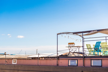 View of the roof of a building against a blue sky, Sete, France. Copy space for text