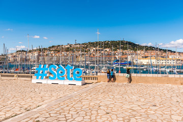 Large letters on the embankment of the city, Sete, France. Copy space for text.