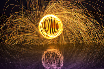 Light painting / light drawing with fire and steel wool  on the lake