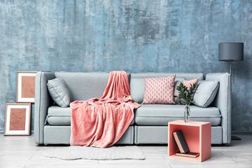 Modern room design with grey sofa