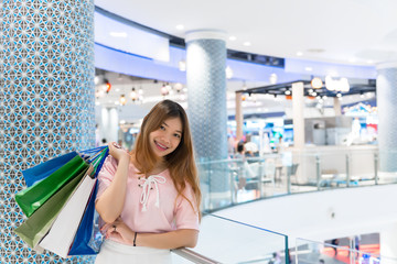 Asian hippie girl shopping in the Department store,Happy woman with shopping bags in hand in the shopping mall,thailand people,Ladies like to buy the best.