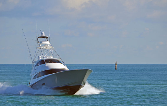 A luxury sport fishing boat returning from a day at sea.