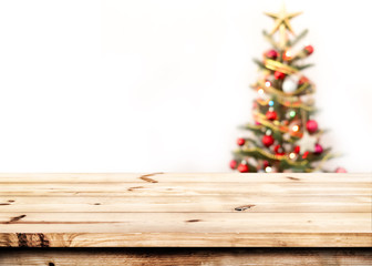 Wall Mural - Christmas and New year background with empty  wooden deck table over christmas tree and blurred light bokeh. Empty display for product montage. Xmas background.