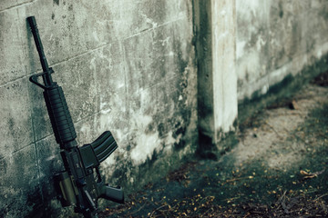 M4A1 (AR-15), M-16 assault rifle gun for the American military is placed beside the old wall.