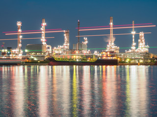long exposure shot of oil refinery plant against blue evening sky