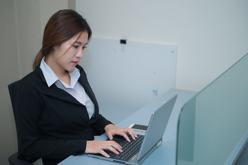 Secretary working for boss,Asian beautiful businesswoman think work in the office,vintage style,dark tone,thailand people