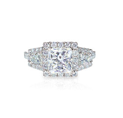 Diamond solitaire engagment wedding ring isolated on white