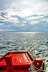 Red Boat speed boat on the beautiful sea with sky natural beauty.