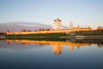 The Pskov Kremlin in the rays of the setting sun on October evening. Russia