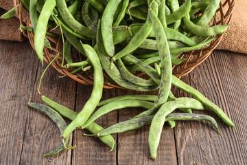 Green beans pods on a wooden table