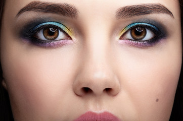 Closeup macro portrait of female face. Woman with evening beauty makeup