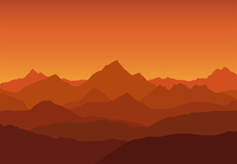 Deurstickers Bruin panoramic view of the mountain landscape with fog in the valley below with the alpenglow orange sky