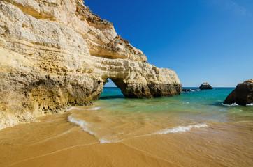 View of limestone cliffs of the Three Castles beach in Portimao, District Faro, Algarve, Southern Portugal