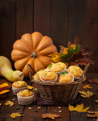 Appetizing and ruddy muffins with pumpkin and walnut.