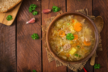 Traditional Russian soup with cabbage - sauerkraut soup. Flat lay. Top view