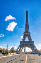 Wall Mural - PARIS, FRANCE - DECEMBER 2012: Tourists visit Eiffel Tower. The city attracts 40 million people every year