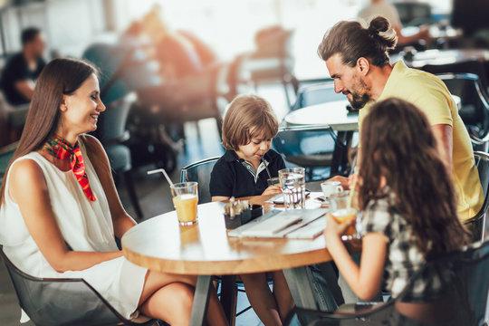 Four-member family having great time in a restaurant