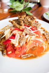 Som Tum Papaya salad with crab. spicy thai food.