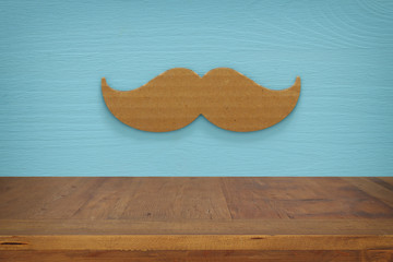 Empty table over paper mustache background. For product display